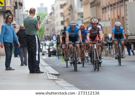 ZAGREB, CROATIA - APRIL 26, 2015: Tour of Croatia, Stage 5 in Zagreb. People on street encouraging and taking photos of group of unidentified cyclist.