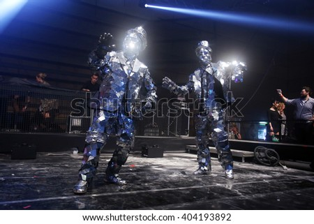 ZAGREB, CROATIA - APRIL 9, 2016 : Two performers dressed in a robbot suite dancing on the stage on La Fiesta Stage by Sensation party in Hypo center in Zagreb, Croatia. - stock photo