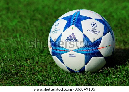 ZAGREB , CROATIA - 13 AUGUST 2015 - close up of European champions league official machball football from Adidas on the grass field , product shot