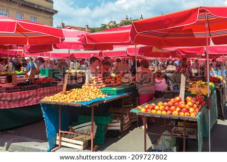 ZAGREB, CROATIA - AUGUST 8, 2014: Customers and sellers at Dolac, the famous open air farmer's market of agricultural products in Zagreb, one of city's most notable landmarks.