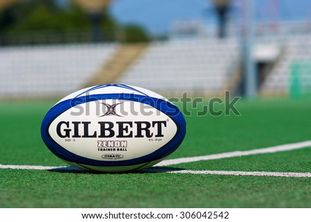 ZAGREB , CROATIA - 13 AUGUST 2015 -  official rugby ball by Gilbert on the green field , product shot