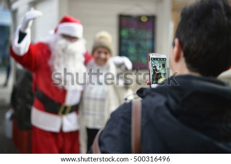 ZAGREB, CROATIA - 14 DECEMBER, 2015: Taking photos with Santa. Advent in Zagreb Fair was voted as the European Best Destination for 2016.