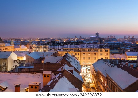 ZAGREB, CROATIA - DECEMBER 31, 2014: View on Zagreb's snow covered rooftops from upper town during the blue hour.