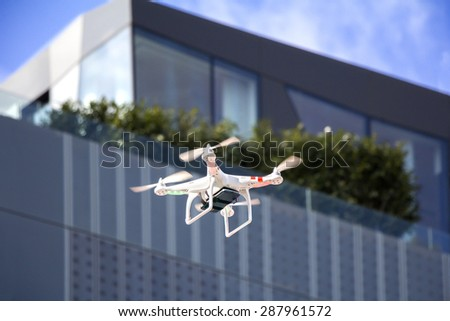 ZAGREB / CROATIA, February 21, 2015: Airborne radio controlled quadcopter drone flying with cell phone camera mounted on a home made platform - stock photo