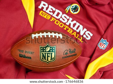 ZAGREB , CROATIA - FEBRUARY 14, 2014 :  NFL Washington redskins club equipment with NFL official ball, product shot - stock photo