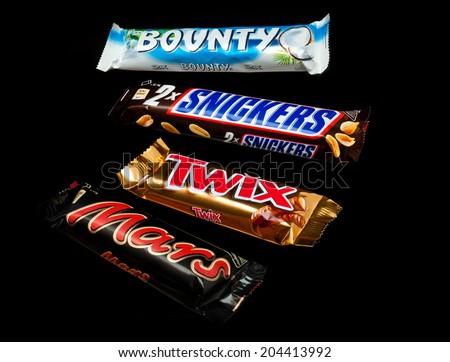 ZAGREB , CROATIA - JANUARY 24 ,2014 : chocolate candy bar twix ,mars, snickers and bounty on black background , product shot - stock photo
