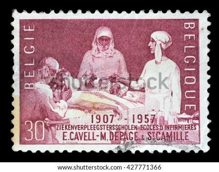 ZAGREB, CROATIA - JULY 03: A stamp printed by Belgium shows Nursing school, circa 1957, on July 03, 2014, Zagreb, Croatia - stock photo