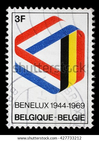 ZAGREB, CROATIA - JULY 03: a stamp printed in the Belgium shows Mobius Strip in Benelux Colors, 25th Anniversary of the Signing of the Customs Union, circa 1969, on July 03, 2014, Zagreb, Croatia - stock photo