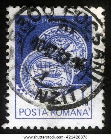ZAGREB, CROATIA - JULY 18: A stamp printed in the Romania, shows Ceramic plate, from Radauti, circa 1982, on July 18, 2012, Zagreb, Croatia - stock photo