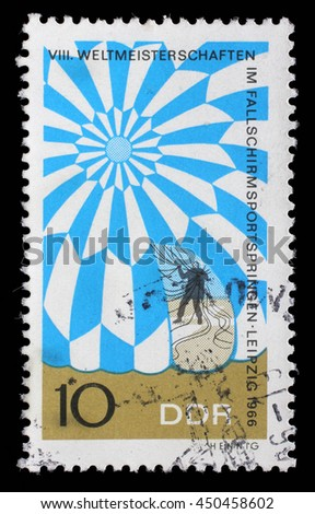 ZAGREB, CROATIA - JULY 02: GDR stamp dedicated to the World Championship in parachute jumping in Leipzig, circa 1966, on July 02, 2014, Zagreb, Croatia - stock photo