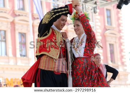 ZAGREB, CROATIA - JULY 17: Members of folk group Dubrovacki primorski svatovi from Gornja Sela, Croatia during the 49th International Folklore Festival in center of Zagreb, Croatia on July 17, 2015 - stock photo