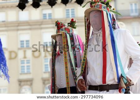ZAGREB, CROATIA - JULY 18: Members of folk group from Putnikovici, Croatia during the 49th International Folklore Festival in center of Zagreb, Croatia on July 18, 2015 - stock photo