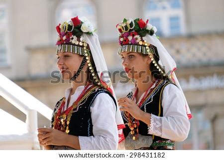 ZAGREB, CROATIA - JULY 19: Members of folk group Kitka from Istibanja, Macedonia during the 49th International Folklore Festival in center of Zagreb, Croatia on July 19, 2015 - stock photo