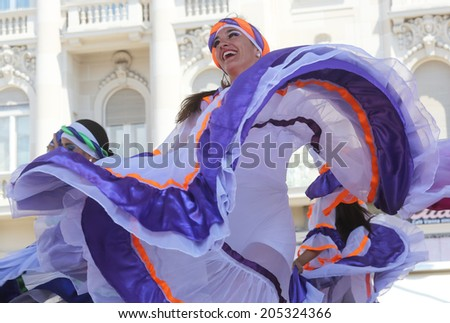 ZAGREB,CROATIA - JULY 16: Members of folk groups Colombia Folklore Foundation from Santiago de Cali,Colombia during the 48th International Folklore Festival in center of Zagreb,Croatia on July 16,2014 - stock photo