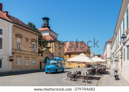 ZAGREB, CROATIA - JULY 11, 2015: New small bus on narrow roads of Upper Town in Zagreb, Croatia
