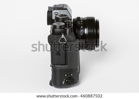 ZAGREB, CROATIA   JULY 30,2016: Photo of FUJIFILM X-T2, 24 megapixels, 4K video mirrorless camera With 35mm 1.4 FUJINON LENS and with an additional battery grip  from the side on white background