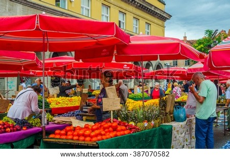 ZAGREB, CROATIA, JULY 28, 2015: Residents shop fresh food from farmers at farmers market near Kvaternik square in Zagreb, Croatia. This is one of biggest and most popular markets in Zagreb.