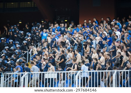 ZAGREB, CROATIA - JULY 12, 2015: 1st Croatian Football League Championship - Dinamo VS Hajduk. Dinamo supporters on north stand fighting with the police. - stock photo