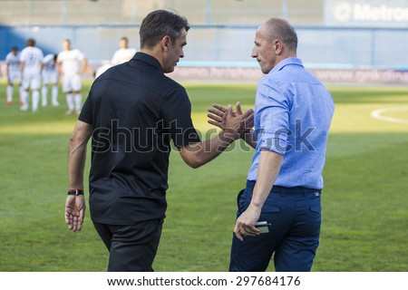 ZAGREB, CROATIA - JULY 12, 2015: 1st Croatian Football League Championship - Dinamo VS Hajduk. BURIC Damir and KRZNAR Damir handshake before the match.