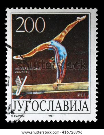 ZAGREB, CROATIA - JUNE 14: A stamp printed by Yugoslavia shows Gymnastics, Universiade in Zagreb, circa 1987, on June 14, 2014, Zagreb, Croatia - stock photo