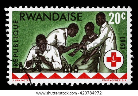 ZAGREB, CROATIA - JUNE 25: A stamp printed in Rwanda is dedicated to the 100th anniversary of the International Red Cross, circa 1963, on June 25, 2014, Zagreb, Croatia - stock photo