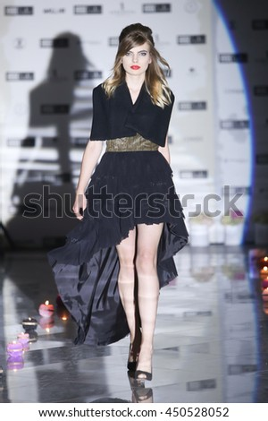 ZAGREB, CROATIA - JUNE 4, 2016 : Model wearing clothes designed by Natalija Smogor on the Fashion Week Zagreb fashion show in the Green Gold Centre in Zagreb, Croatia.