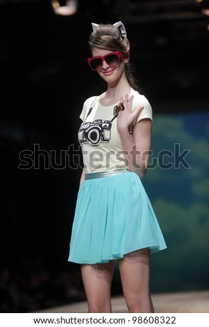 "ZAGREB, CROATIA - MARCH 23: Fashion model wears clothes made by ELFS on ""CRO A PORTER"" show on March 23, 2012 in Zagreb, Croatia."