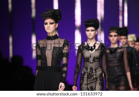 "ZAGREB, CROATIA - MARCH 14: Fashion model wears clothes made by Ivica Skoko on ""PERWOLL FASHION.HR"" show on March 14, 2013 in Zagreb, Croatia."