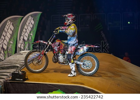 ZAGREB, CROATIA - MARCH 30, 2013: FMX motorbike driver performing on Masters of dirt 2013 - Freestyle motocross show.