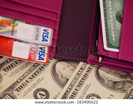 ZAGREB, CROATIA - MARCH 22, 2014: Photo of US dollars bills and credit cards in wallet. US dollar is the official currency of the United States and its overseas territories.  - stock photo