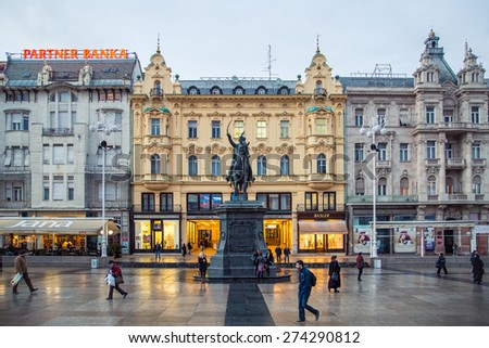 ZAGREB, CROATIA - 11 MARCH 2015: Zagreb's main square with Ban Josip Jelacic statue and surrounding buildings on a wet evening. - stock photo