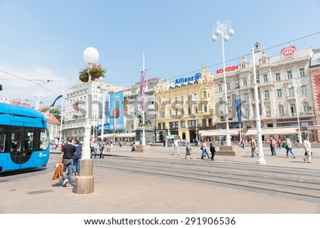 ZAGREB, CROATIA - MAY 23; capital city, Ban Jelacic Square listed among  20 most beautiful squares in Europe, wide thoroughfare,blue passenger rail, architecture, May 23,2011, Zagreb, Croatia. - stock photo