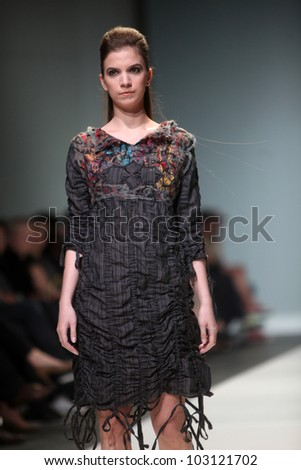 "ZAGREB, CROATIA - MAY 12: Fashion model wears clothes made by Ana Kujundic on ""ZAGREB FASHION WEEK"" show on May 12, 2012 in Zagreb, Croatia."