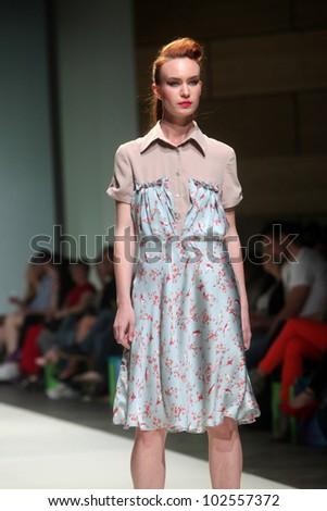 "ZAGREB, CROATIA - May 10: Fashion model wears clothes made by Iggy Popovic on ""ZAGREB FASHION WEEK"" show on May 10, 2012 in Zagreb, Croatia. - stock photo"