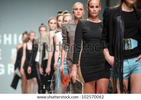 "ZAGREB, CROATIA - May 10: Fashion model wears clothes made by Kristina Burja on ""ZAGREB FASHION WEEK"" show on May 10, 2012 in Zagreb, Croatia. - stock photo"