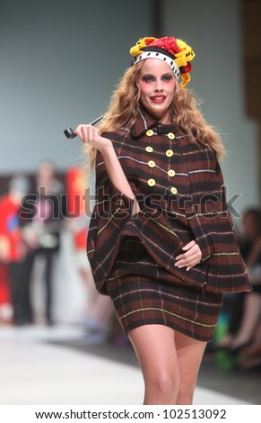 "ZAGREB, CROATIA - MAY 10: Fashion model wears clothes made by The Rodnik Band on ""ZAGREB FASHION WEEK"" show on May 10, 2012 in Zagreb, Croatia."