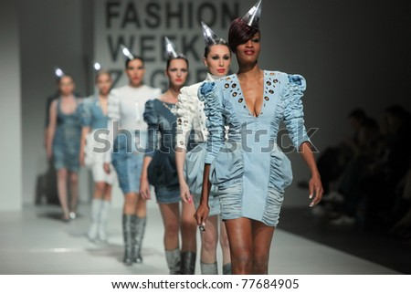 ZAGREB, CROATIA - MAY 19: Fashion models wear clothes made by Ines Zrnc Gregorina in 'Fashion Week' show on May 19, 2011 in Zagreb, Croatia. - stock photo