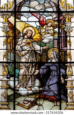 ZAGREB, CROATIA - MAY 28: Jesus and Saint Margaret Mary Alacoque, stained glass window in the Basilica of the Sacred Heart of Jesus in Zagreb, Croatia on May 28, 2015 - stock photo
