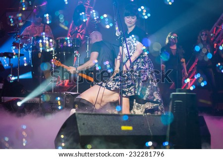 ZAGREB, CROATIA - MAY 23, 2013: Psihomodo Pop's 30th birthday concert  in Dom sportova. Frontman and singer Davor Gobac aunder the skirt of actress Judita Frankovic.  - stock photo