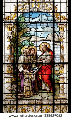 ZAGREB, CROATIA - MAY 28: The Multiplication of the Loaves and Fish, stained glass window in the Basilica of the Sacred Heart of Jesus in Zagreb, Croatia on May 28, 2015 - stock photo