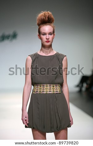 ZAGREB, CROATIA - NOVEMBER 24: Fashion model wears clothes made by Natalija Smogor on 'Fashion Week Zagreb' show on November 24, 2011 in Zagreb, Croatia.