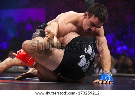ZAGREB, CROATIA - NOVEMBER 2, 2013: Final fights at Croatian MMA legaue. Anto RADMAN (red gloves) VS Tonci PERUSKO (blue gloves).