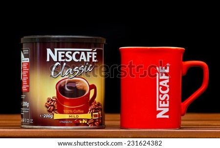 ZAGREB , CROATIA - NOVEMBER 19 ,2014 :   Nescafe classic box and coffee cup on the table, product shot - stock photo