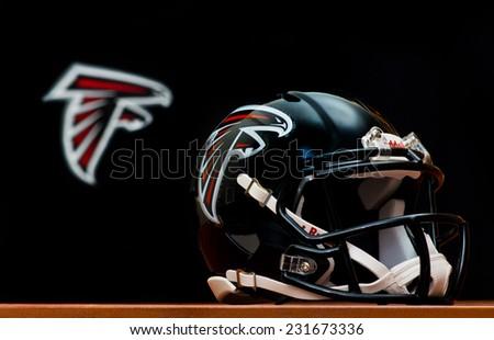 ZAGREB , CROATIA - NOVEMBER 19 , 2014 :  NFL Atlanta Falcons equipment , helmet and flag   ,product shot - stock photo