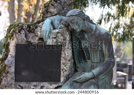 ZAGREB, CROATIA - OCTOBER 28: Detail of a mourning sculpture on a Mirogoj cemetery in Zagreb, Croatia on October 28, 2013. - stock photo