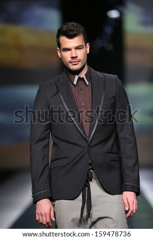 ZAGREB, CROATIA - OCTOBER 19: Fashion model wearing clothes designed by Ivica Klaric on the 'Fashion.hr' show on October 19, 2013 in Zagreb, Croatia.