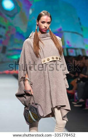ZAGREB, CROATIA - OCTOBER 31, 2015: Fashion model wearing clothes designed by Marina Design and a bag designed by Marija Ivankovic on the 'Fashion.hr' fashion show - stock photo