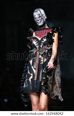 ZAGREB, CROATIA - OCTOBER 26: Fashion model wearing clothes designed by Zigman on the Cro a Porter show on October 26, 2013 in Zagreb, Croatia.