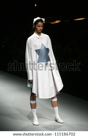 "ZAGREB, CROATIA - OCTOBER 08: Fashion model wears clothes made by DIORALOP by Andreja Bistricic i Maja Merlic  on ""CRO A PORTER"" show on October 08, 2012 in Zagreb, Croatia."