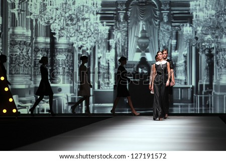 ZAGREB, CROATIA - OCTOBER 19: Fashion models wearing clothes made by Monika Sablic at 'Croaporter' fashion show, on October 19, 2012 in Zagreb, Croatia. - stock photo